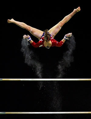 the U.S. competes in a qualifying session of the women's Uneven Bars ...