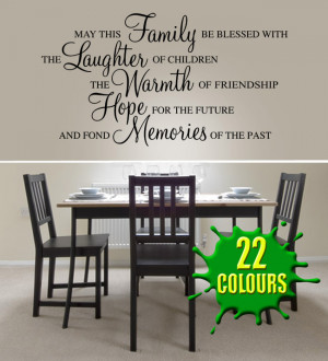 Black May this family be blessed wall decal beside a dining table