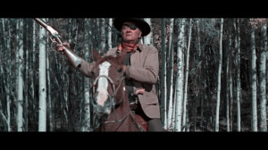 John Wayne as Marshall Reuben J. 'Rooster' Cogburn in True Grit (1969)
