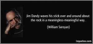 Jim Dandy waves his stick over and around about the rock in a ...