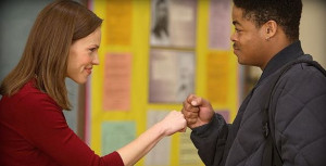 Hillary Swank, portraying Erin Gruwell, fist-bumps with a student in ...