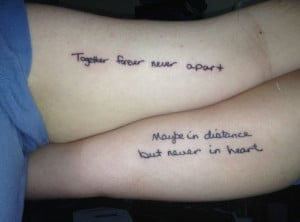 Mother - daughter tattoo in each others handwriting.