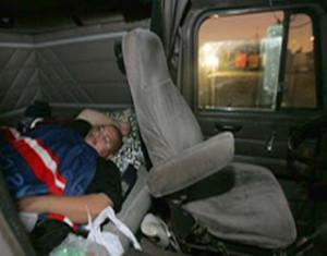 trucker-taking-rest-in-his-truck