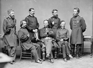 ... Davis, standing second from right, with General Sherman and his staff
