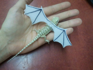 ... PAPER WINGS ON THIS BABY BEARDED DRAGON AND NOW IT'S JUST A DRAGON