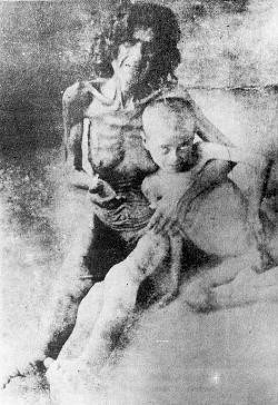 Starving Armenian woman and child after reaching 'refuge'.