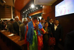 Newly elected Nepalese Prime Minister Sushil Koirala greets media ...