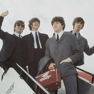 The Beatles leave London airport in 1964. From left: John Lennon ...