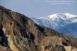 Snow-capped mountain and barren eroded hills, Death Valley National ...