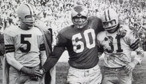 ... (60) with Green Bay Packer's Paul Hornung (5) and Jim Taylor (31