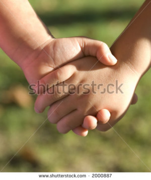 Two sisters holding hands on a summers day - stock photo