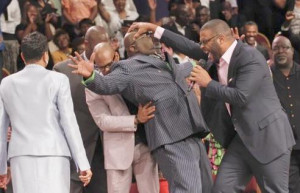 Tyler Perry Laying hands on Bishop T.D. Jakes