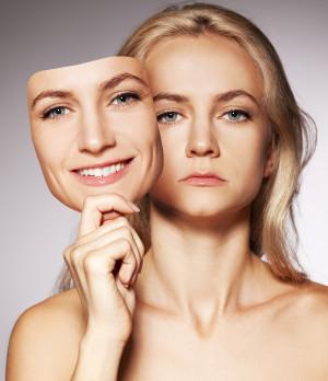 bigstock-Woman-hiding-under-the-happy-mask-022613