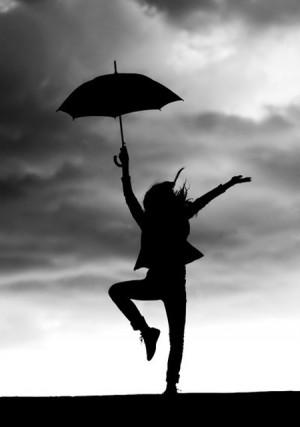girl dancing and feel the gentle kiss of the rain.