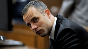 South African Paralympic athlete Oscar Pistorius sits in the dock ...