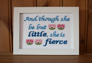 Cross-stitched on antique white fabric, 14 count.