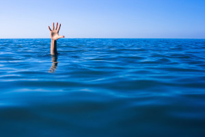 Drowning Man Drowning man's hand in sea or