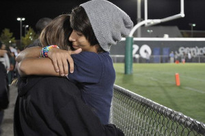 boy, couple, cute, cute couple, football game, girl, happy, hugging ...
