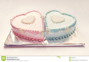 Birthday cakes for twins, for a boy and a girl, shape of hearts.