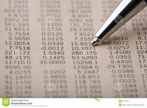 Financial Quotes page section in a finance newspaper. Pen pointing at ...