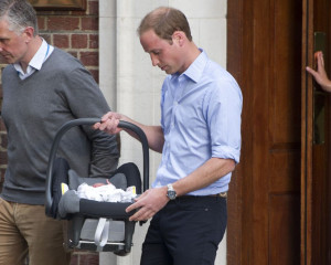 Strapped in: The newborn baby was strapped into a car seat as Prince ...