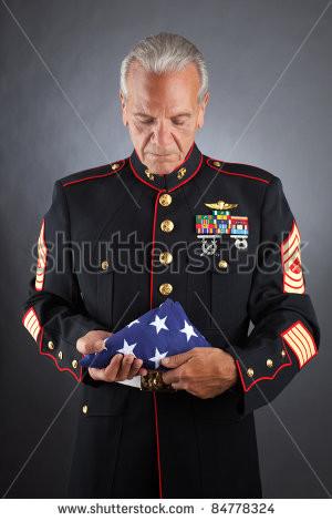 Sad Marine Pics Sad marine holds a flag