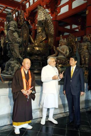 Prime Minister Narendra Modi, center, and his Japanese counterpart ...