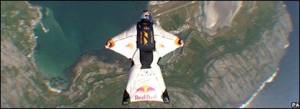 Swiss stuntman haspleted a daring 17km unaided flight over the