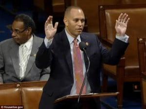 New York Rep. Hakeem Jeffries makes the 'hands up don't shoot' gesture ...
