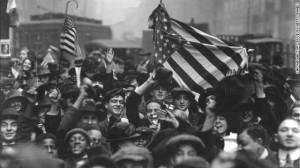 Armistice Day peace celebration, crowd of mostly boys, on a street ...