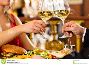 Happy couple have a romantic date in a fine dining restaurant they ...