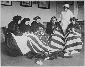 Patriotic women, who had emigrated to America, work on the flag in ...