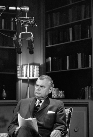 Photograph of John G. Diefenbaker seated in a radio broadcast studio ...