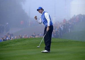 Europe Ryder Cup player Rory McIlroy celebrates a birdie in the fog.