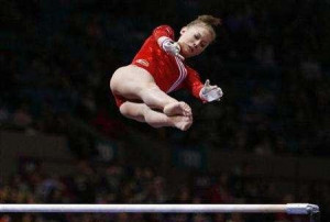 gymnast Shawn Johnson competes on the uneven parallel bars at the ...