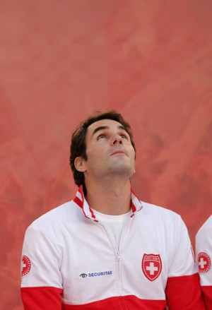 Switzerland's Roger Federer looks up as he attends the Davis Cup final ...