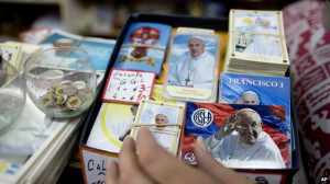 Artefacts with the image of Pope Francis are displayed at a shop in ...