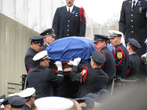 Worcester Firefighters bringing the casket with Fire ...