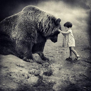 Funny photos funny cute little girl hugging grizzly bear