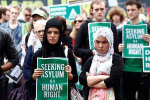 Australia ends asylum by boat, begins debate over racism