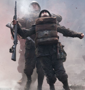 under fire in a scene from new Chinese movie epic Flowers of War ...
