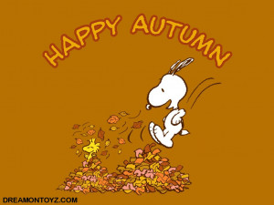 Happy Autumn - Woodstock and Snoopy playing in a pile of leaves