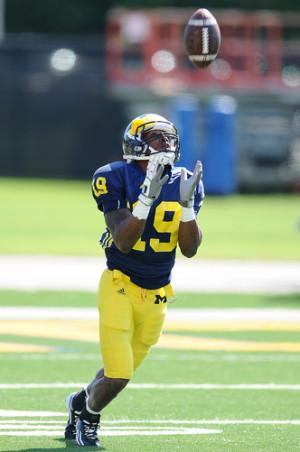 Michigan senior wide receiver Kelvin Grady hauls in a kickoff during a ...