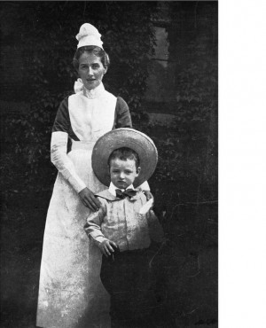 Edith as a governess with a young boy