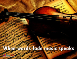 Violin is on the book, Life quote with violin