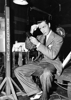 Paul Henreid on the set of Now, Voyager (1942).