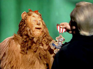 Bert Lahr as the Cowardly Lion receives his courage award from Frank ...