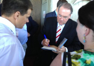 Mike Huckabee signs at book at the Family Leadership Summit in Ames on ...