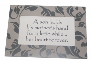 son holds his mother's hand for a little while... her heart forever.