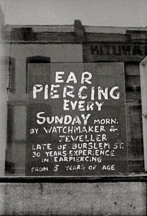 Ear piercing, Spitalfields 1964. Is this ear piercing done to people ...